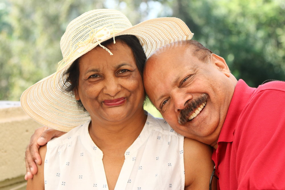 Older Asian couple smile lovingly