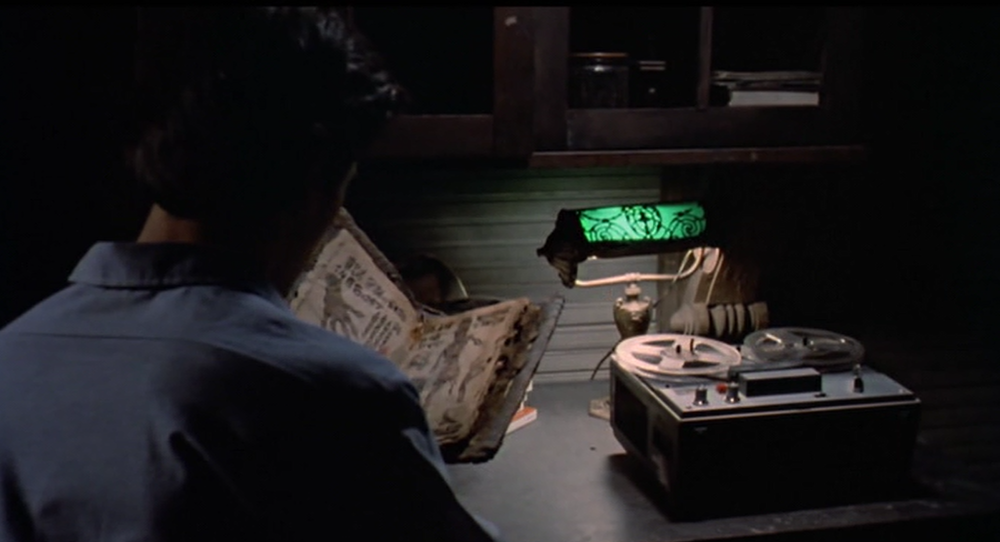 Ash with the Necronomicon and tape recorder