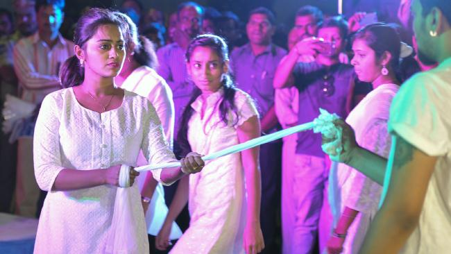 Indian youths perform a show in Hyderabad to promote awareness of sexual exploitation.