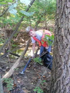 Sue Rahall, Council Volunteer, at the Upper Mill Creek Cleanup