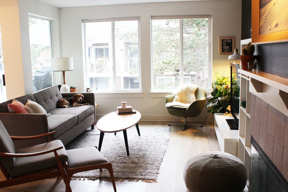 AFTER:  Reducing clutter, rearranging furniture and adding some plants and artwork creates a much warmer, welcoming living space.