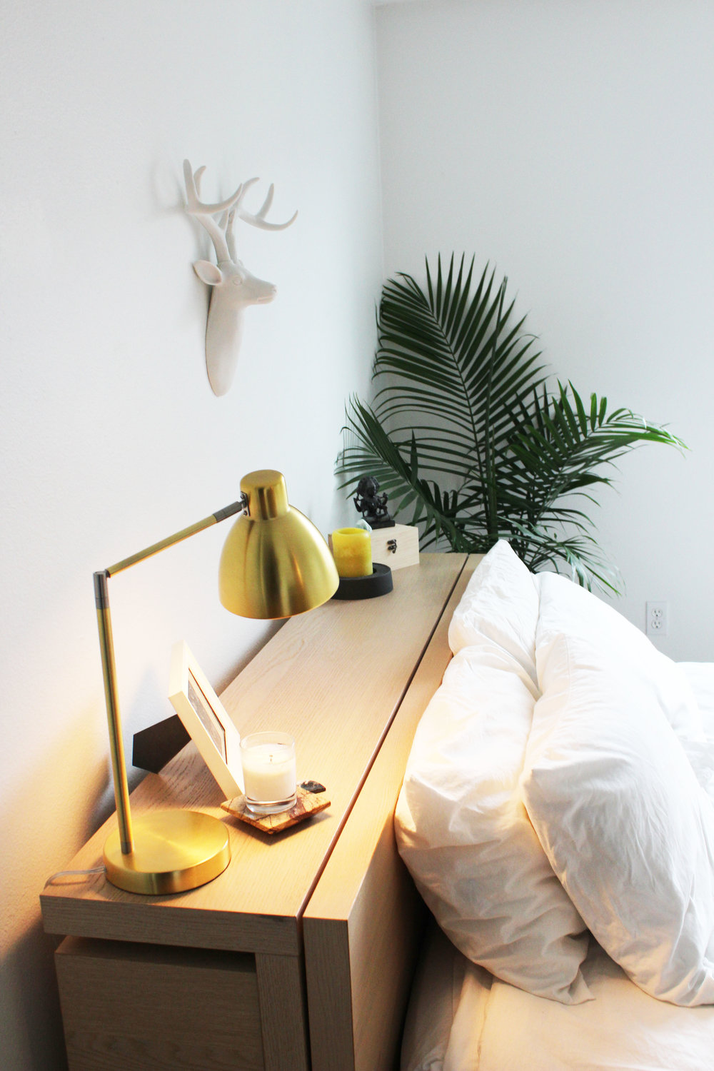 AFTER:  By simply adding a new lamp and a sculpture she had in the closet, the feeling of the bedroom is transformed. Meaningful and inspiring objects now greet Melissa in the morning, setting the tone for her day.