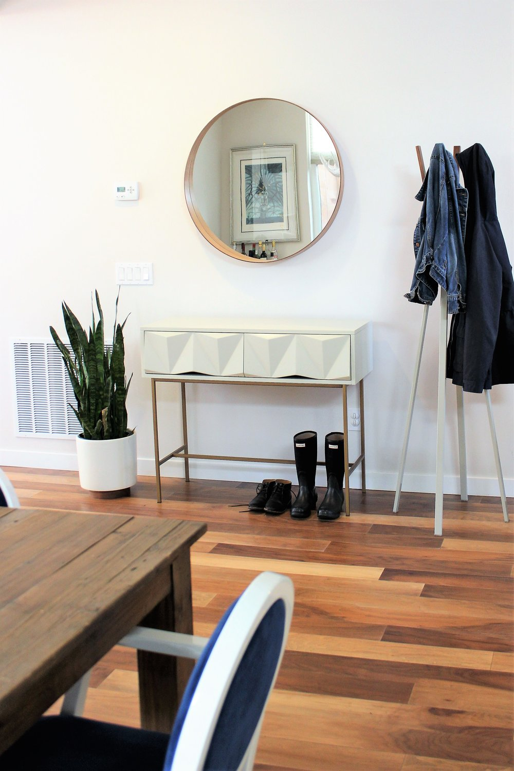 This minimalist entryway creates a space to help keep things organized when coming home from a busy day at work. This functional, yet beautiful entryway is perfect for dropping bags, keys, shoes and jackets.