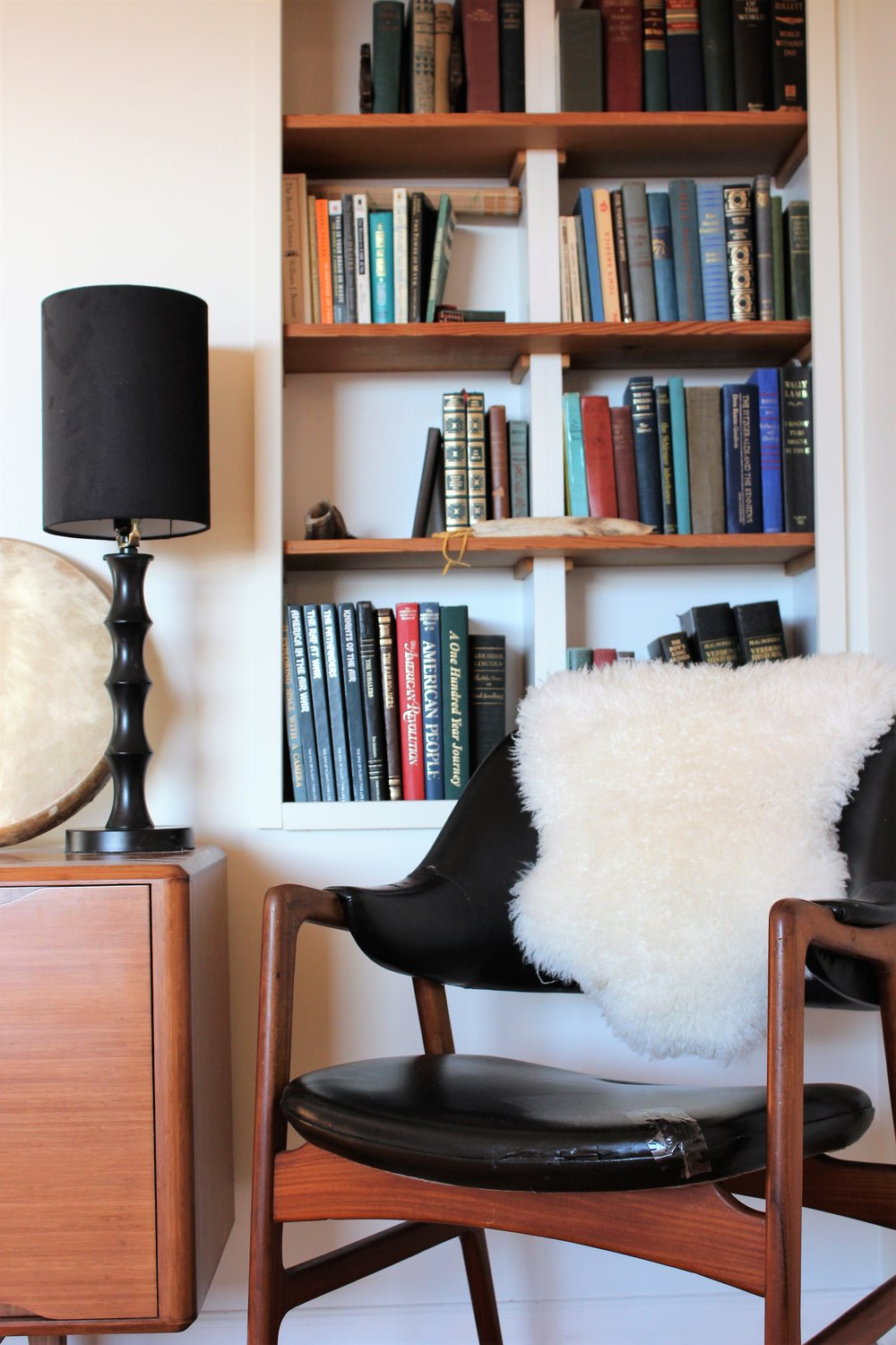 This lovely little reading nook is so inviting! I just want to curl up with one of these books in my client's collection.