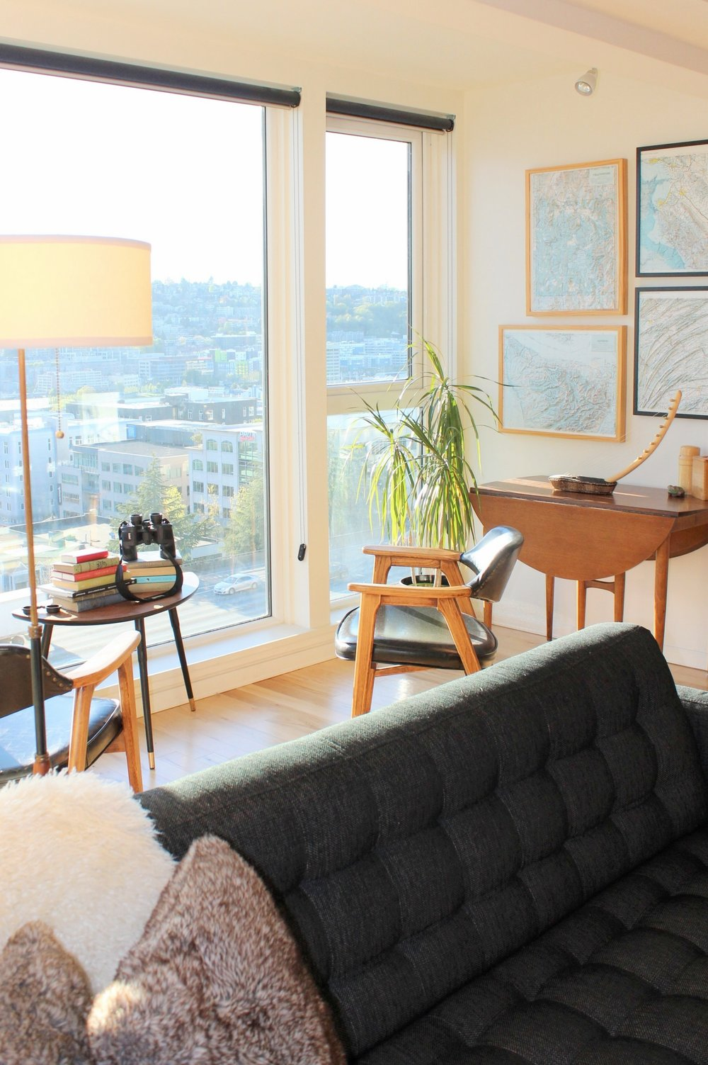 The view of South Lake Union and downtown Seattle is gorgeous! The afternoon light fills the warm, mid-century inspired space.