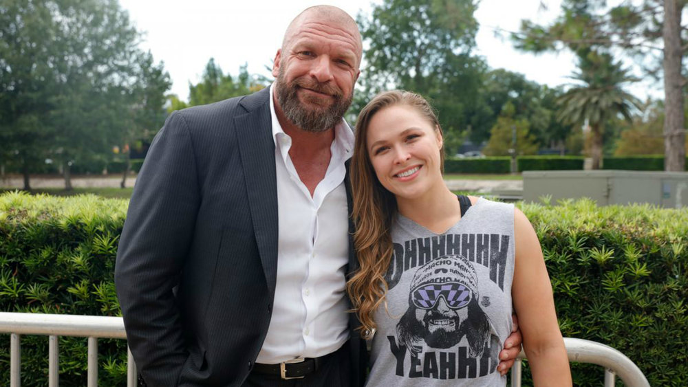 Ronda Rousey pictured with Triple H (Photo Credit: WWE.com)