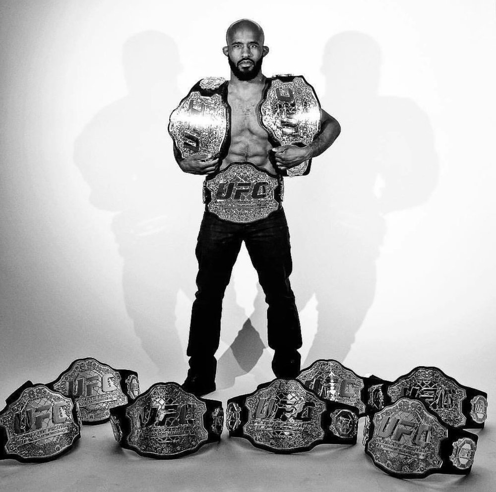 Johnson posing with his ten UFC world championships / IMG Source:http://bit.ly/2eN0ZoS