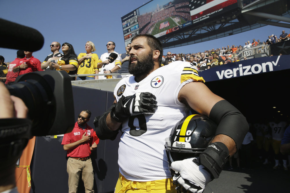 Alejandro Villanueva, the left tackle for the Pittsburgh Steelers, stands alone for the National Anthem as his other teammates stayed inside of the locker room in silent protest of injustice and in light of President Trump's most recent tweets. Villanueva is a former Army Ranger and has been decorated with a Bronze Star for valor.