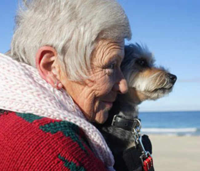 older-woman-and-dog-beach.jpg