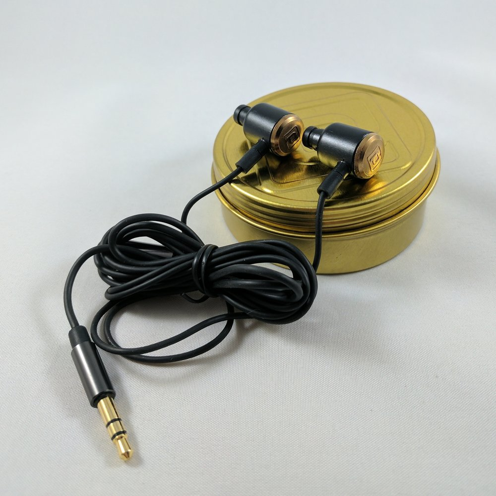 3 Headphones on Tin.jpg