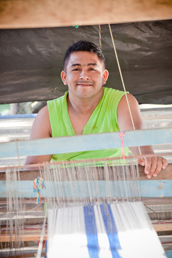 José Ramón on the loom he built