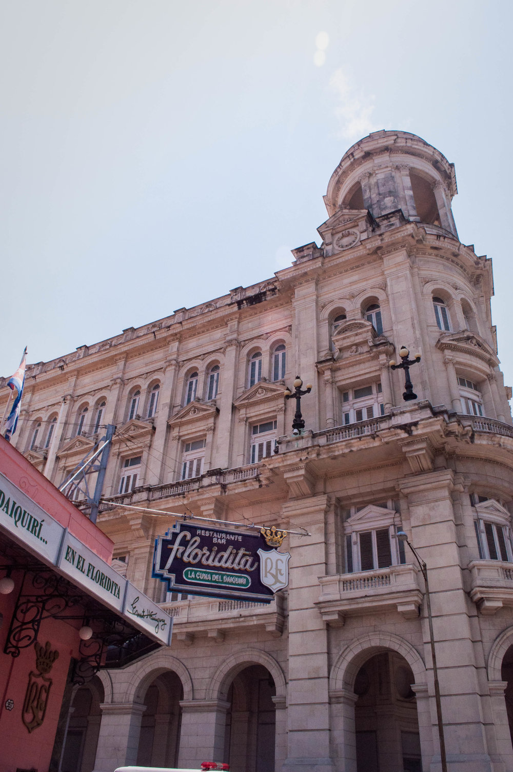 Old pink colonial building in La Havana with La Floridita sign