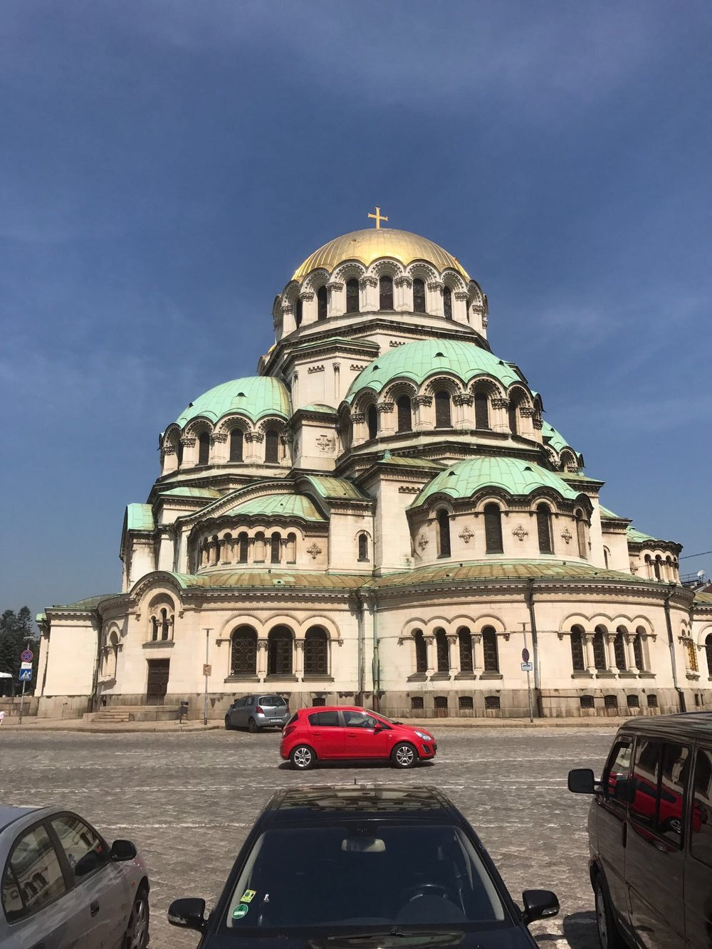 Alexander Nevsky Cathedral in Sofia (Bulgaria) with a red car in the foreground