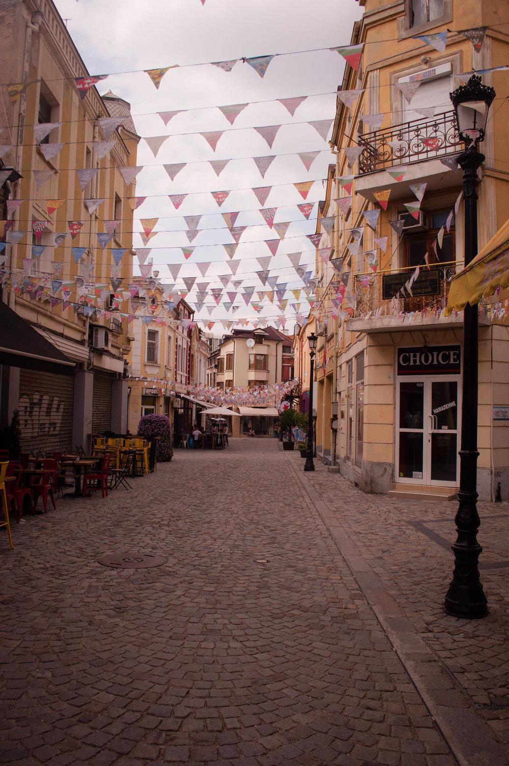 Street in Kapana,  Ploviv (Bulgaria) with streamers and graffiti.