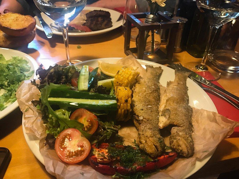 Bulgarian traditional dish in the Pavaj restaurant located in in Kapana, Ploviv (Bulgaria). The dish has veggies and fried fish
