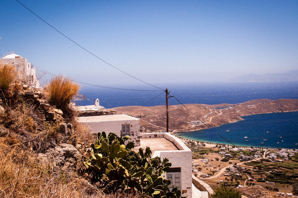 White house in Serifos's hill overlooking the coast with the blue sea