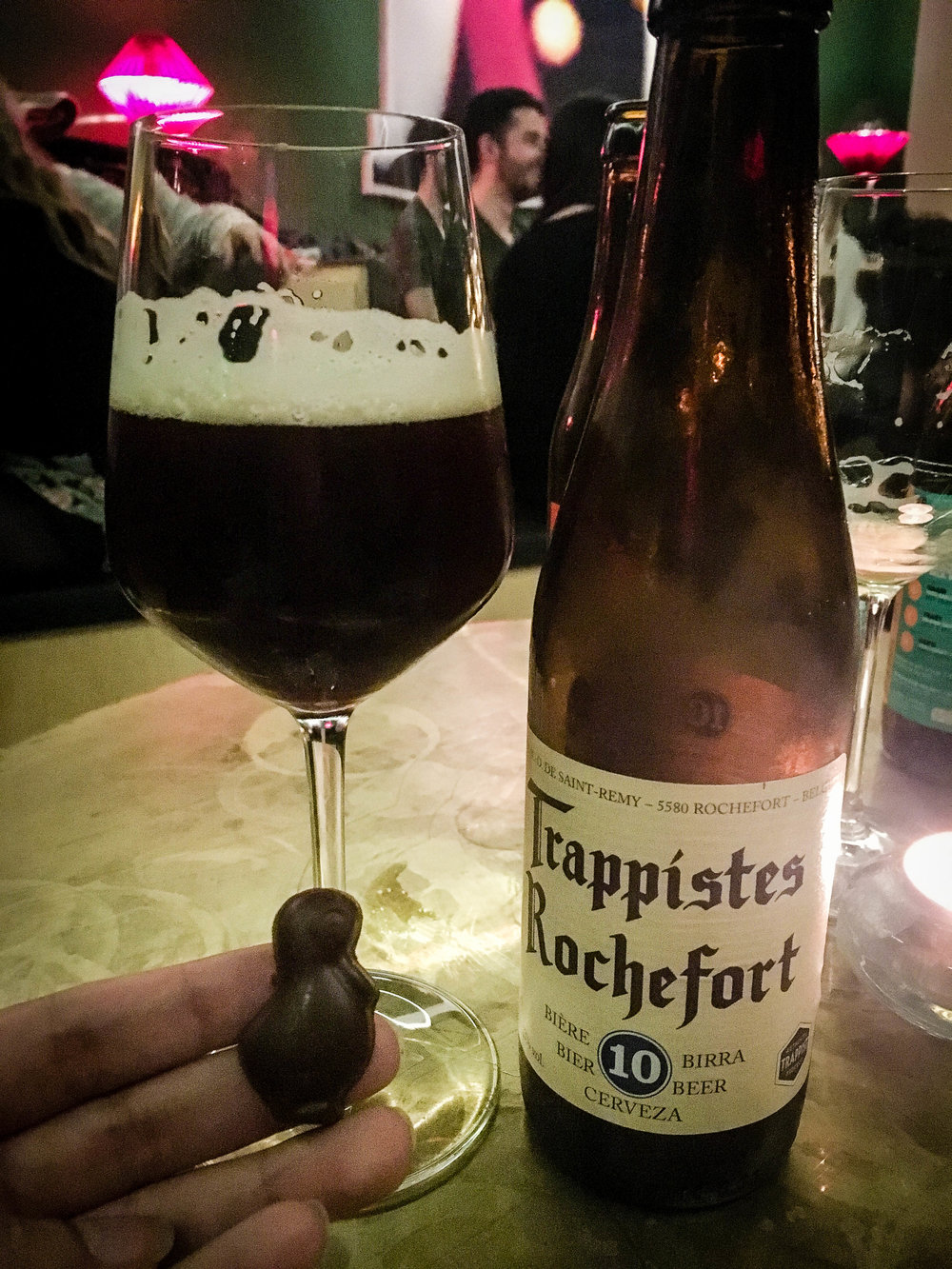 Trapiste Rochefort a Belgian beer tasting a a dark chocolate praline during our Brussels Beer and Chocolate Tour given by Brussels Journey