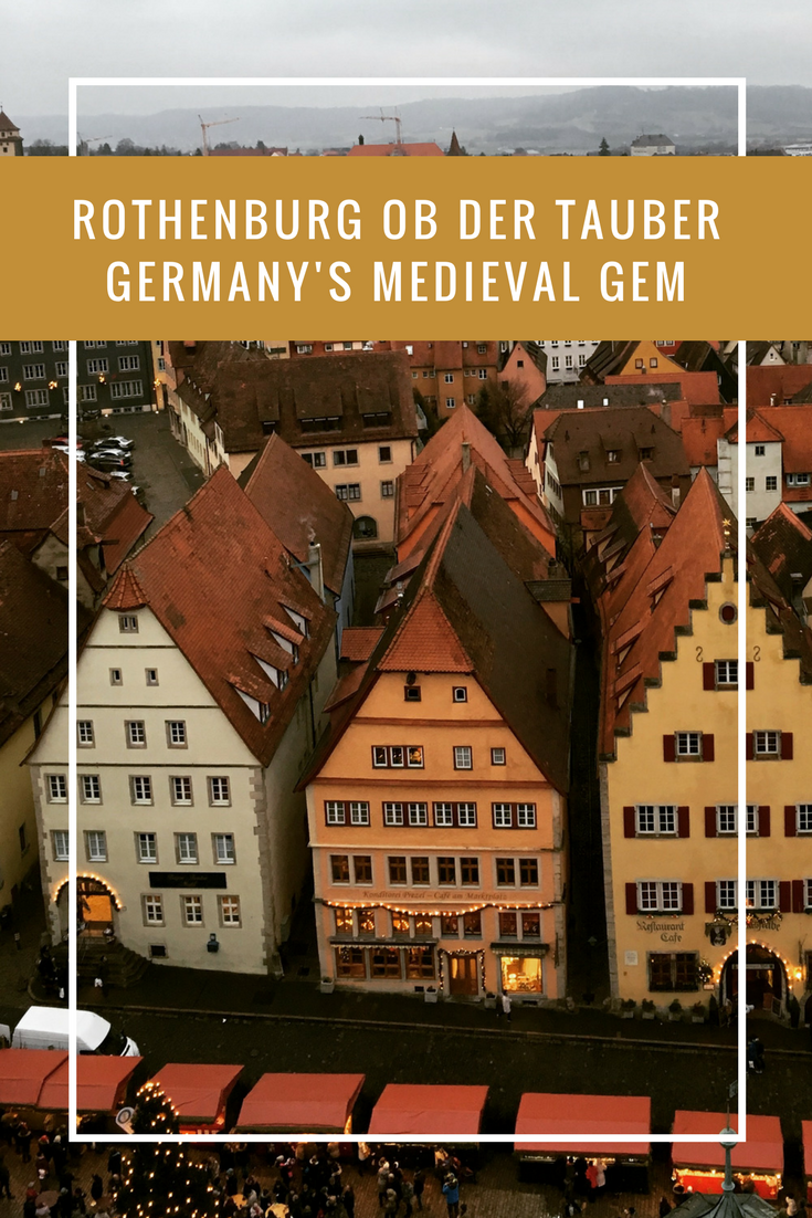 "Images optimized for Pinterest with the text "" Rothenburg ob der Tauber"" Germany's Medieval Gem. On the background there are medieval buildings seen from the tower of the city hall"