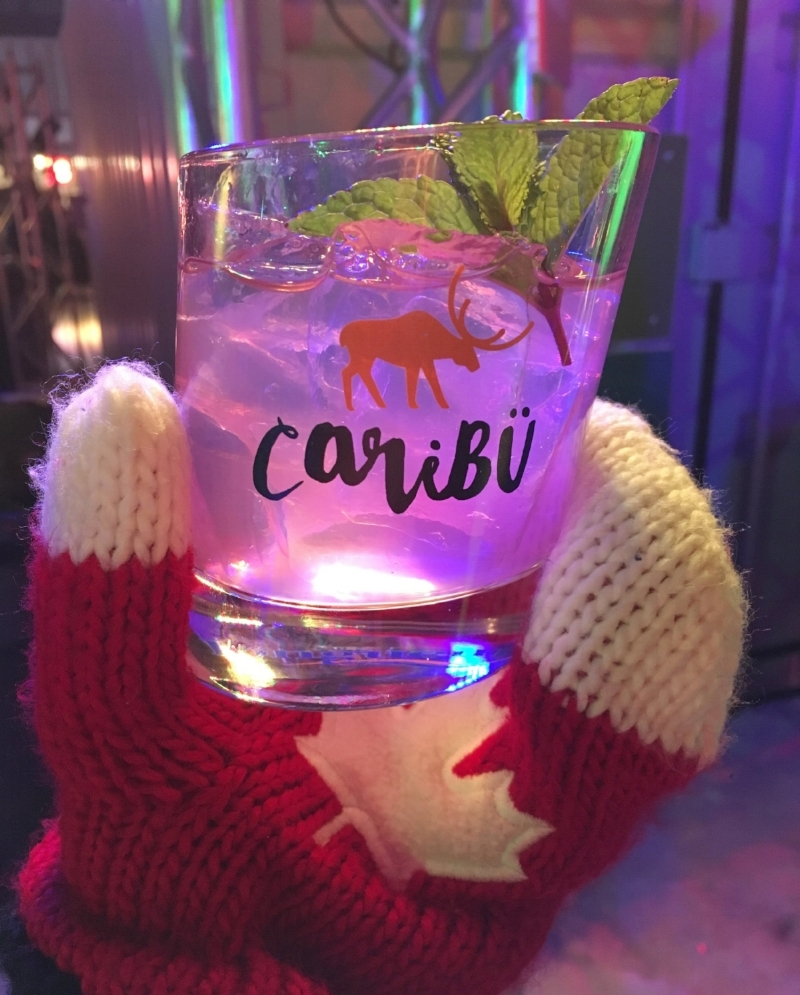 Cocktail glass with the Caribu festival logo with a Canadian mitten. The Caribu Festival is a spirit festival close to Montreal in winter