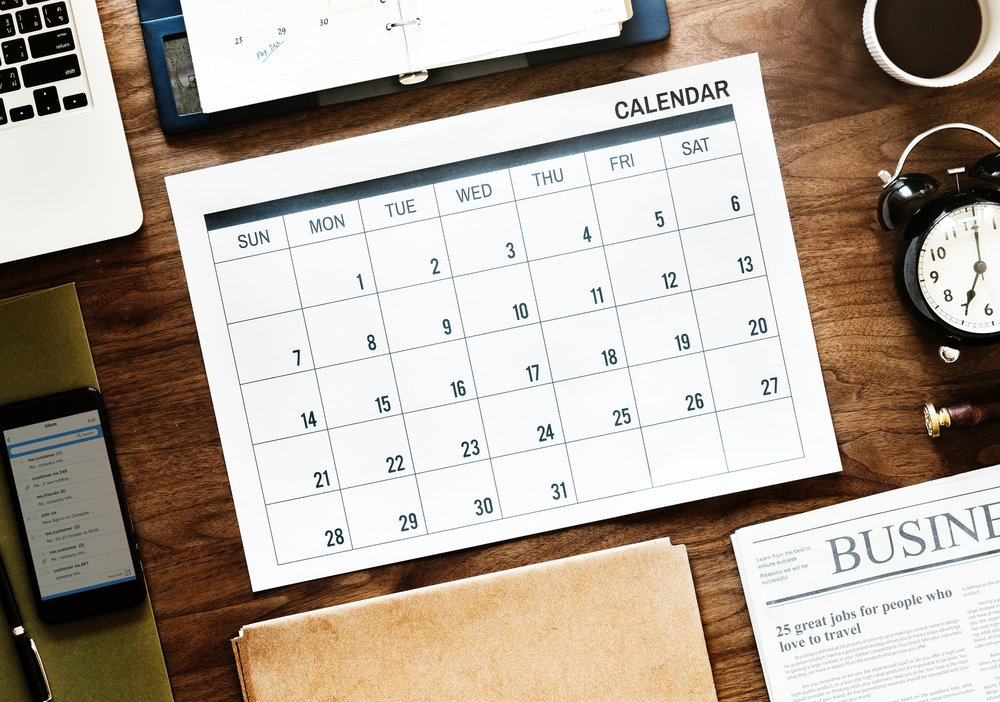 Flay lay of a calendar. Planning is part of the Checklist: 12 Things to do at work before going on vacation