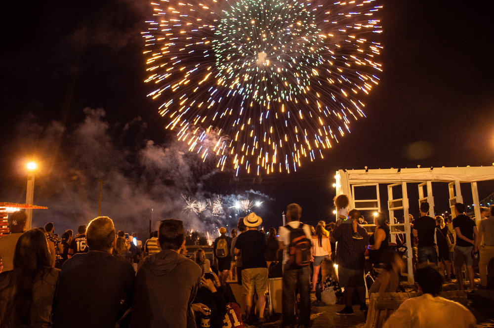 Fireworks at Village au Pied-du-Courrant, one of the 6 original terraces to enjoy the summer in Montreal