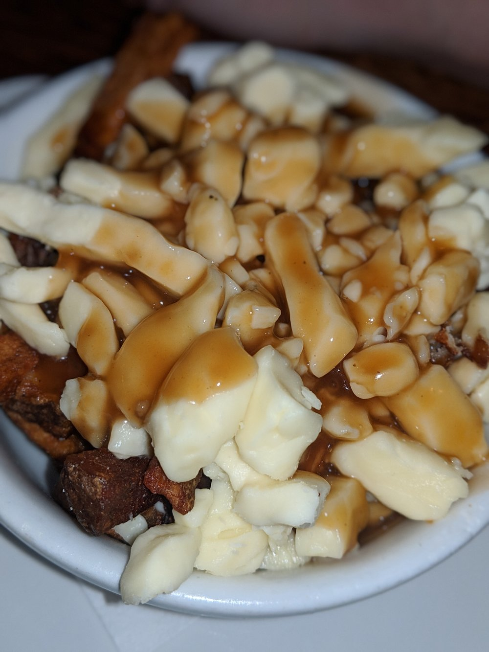 Poutine is a famous food in Montreal. 10 must-eat food in Montreal