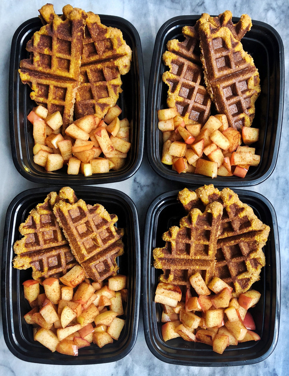Breakfast meal prep for fall with paleo pumpkin waffles and cinnamon apples. Prep four servings on Sunday and have a delicious breakfast prepped all week.