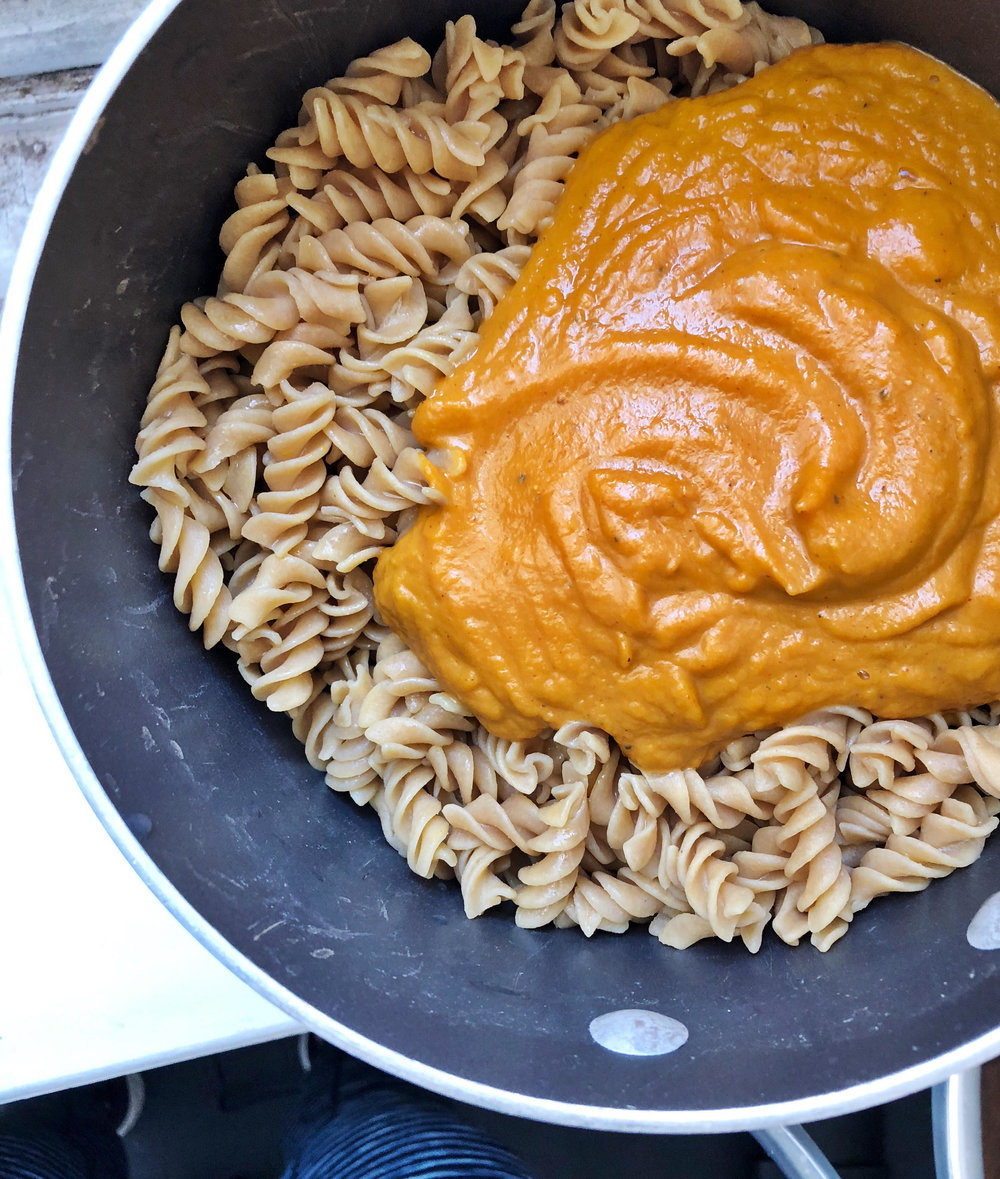 This spicy pumpkin pasta sauce is rich and flavorful, but is still easy to make and is made with all plant based ingredients. Spicy pumpkin pasta is the perfect meal to feed your family before they chow down on all the halloween candy!