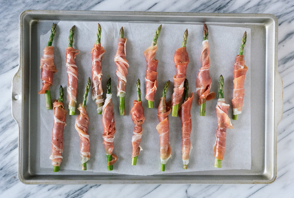 Prosciutto wrapped asparagus are the perfect whole30, paleo or anytime snack and appetizer. They are a snack that anyone in my family can agree on. Grab the recipe for this simple and delicious snack.
