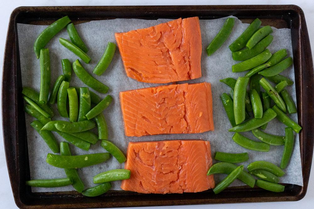 Simple sheet pan salmon is the easiest way to cook up a healthy dinner in less than 30 minutes. This is a whole30 and paleo approved one pan meal.