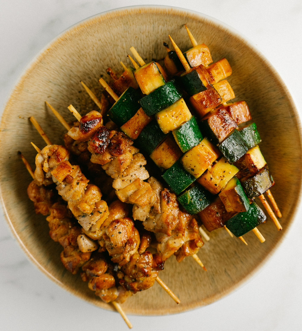Grill up some chicken thigh and zucchini yakitori tonight. These mini skewers are a quick and easy dinner option. Double the recipe and save half for lunch tomorrow! These skewers are paleo and whole30 friendly.