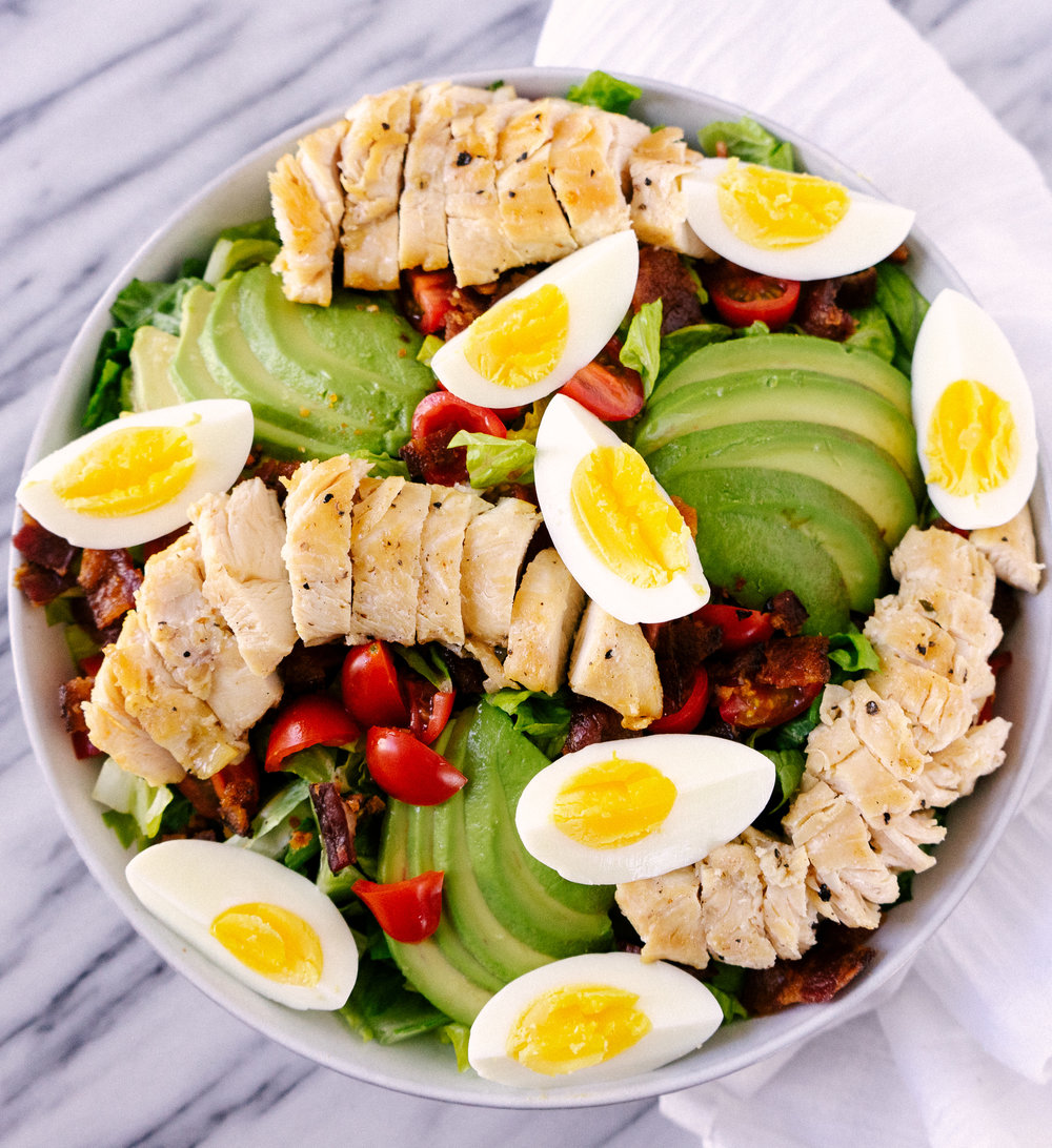 This Whole30 cobb salad with spicy cashew dressing is a delicious whole30 or paleo lunch or anytime meal! I like to prep a few of these at a time so that I am ready for busy weeks. The dressing is the perfect addition to jazz up any salad.
