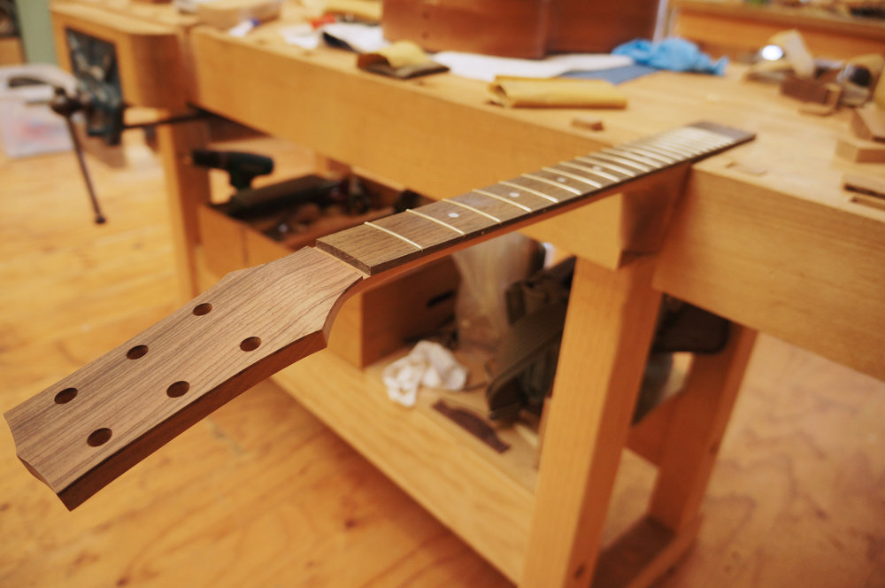 head shaped and drilled for tuners.JPG