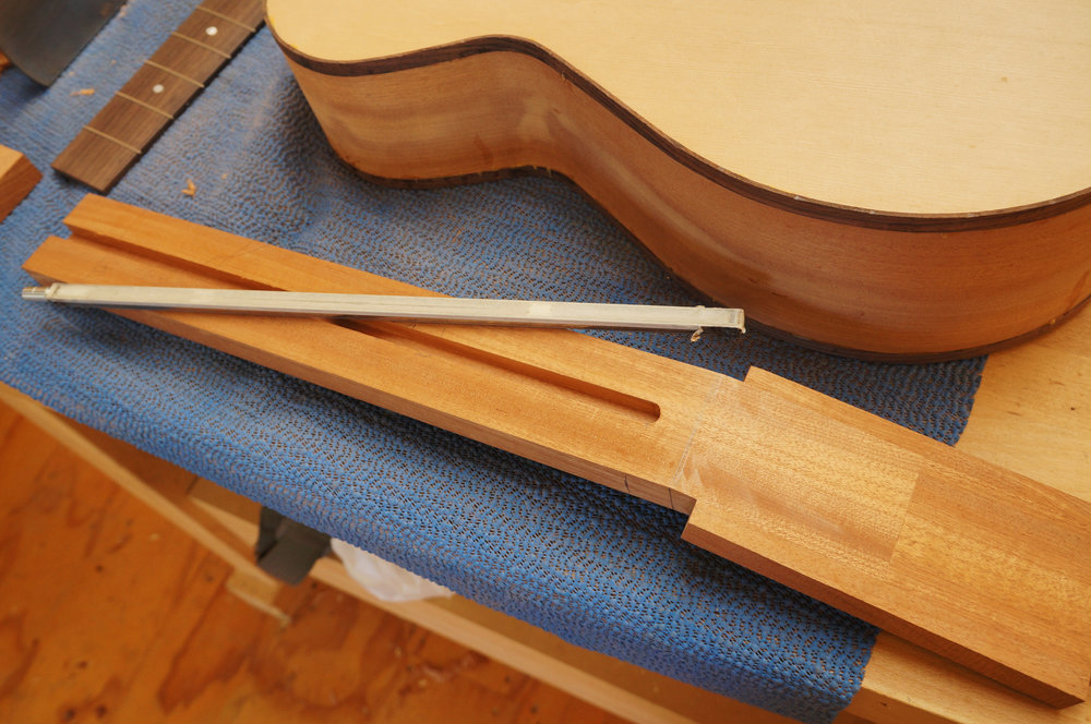 showing scarf joint planed smooth, reinforcing wings glued on, and truss rod slot routed.JPG