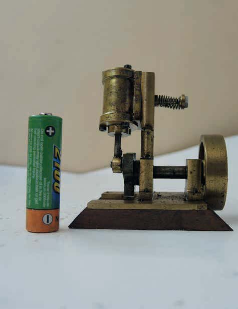 A double-acting single-cylinder steam engine built from scrap brass