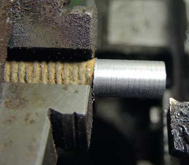 The beginning of making the outer body—a piece of old mild steel was machined to the diameters to take ¼ inch (6.35 mm) thread and a hexagon.