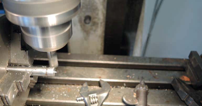 The hexagon being milled in the dividing head on the mill