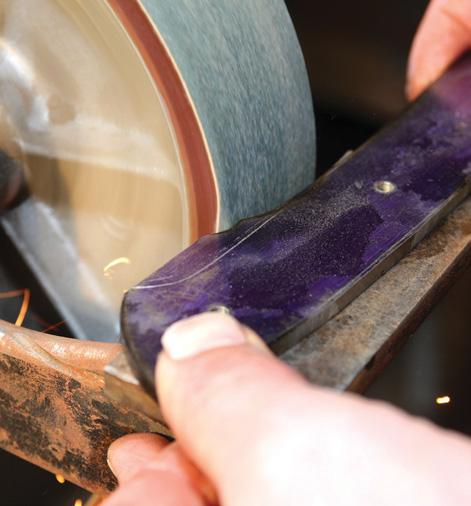 Belt over edge of wheel grinds small corners