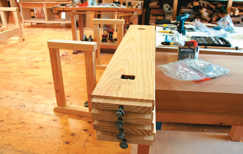 For bolted-on benchtop end rails and long rails in base, mortises were routed in the underside to locate captured nuts