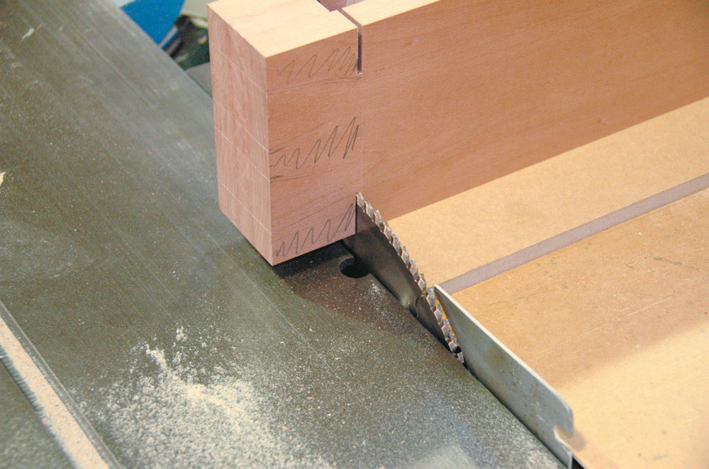 Using circular saw to cut shoulders of dovetails