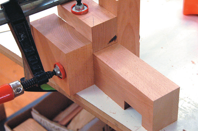 Extra blocks clamped in place to steady router while running groove