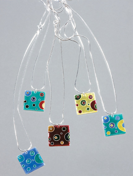Finished enamelled pendants. Varied colours give different results even on a very simple design