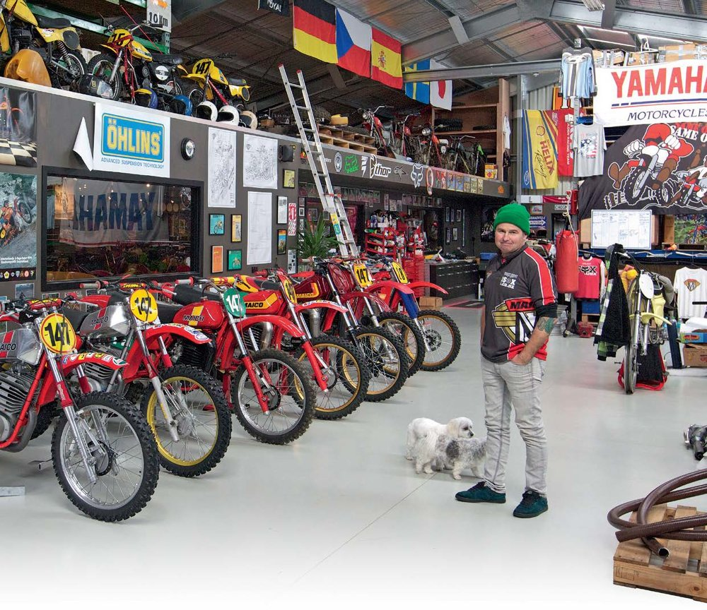 Steve Gallichan and his collection of vintage Maico bikes. Maltese cross pets Alfie and Bella in attendance.