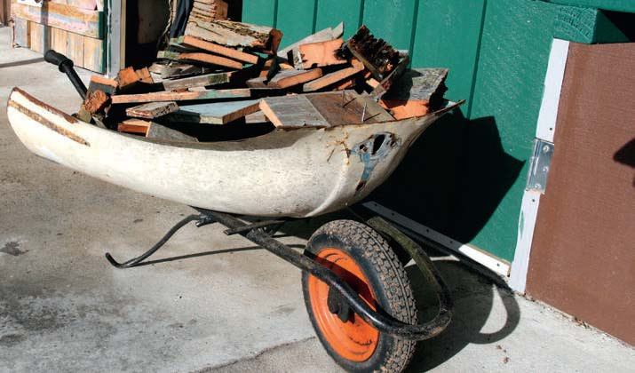 A car bonnet has a new lease of life as part of a wheelbarrow.