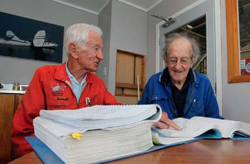 Former air force engineers Mike Jackson(left) and Donr Barr with the maintenance manual