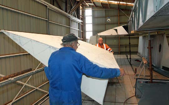 Don Barr and John Emeny fitting the fabric trailing edge section
