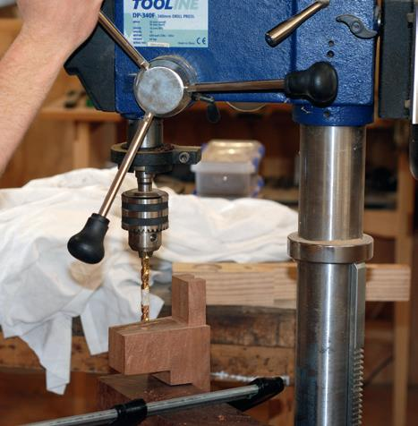 Drilling holes for neck bolt threaded inserts