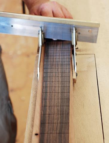 Mitre box and fret saw cutting frets