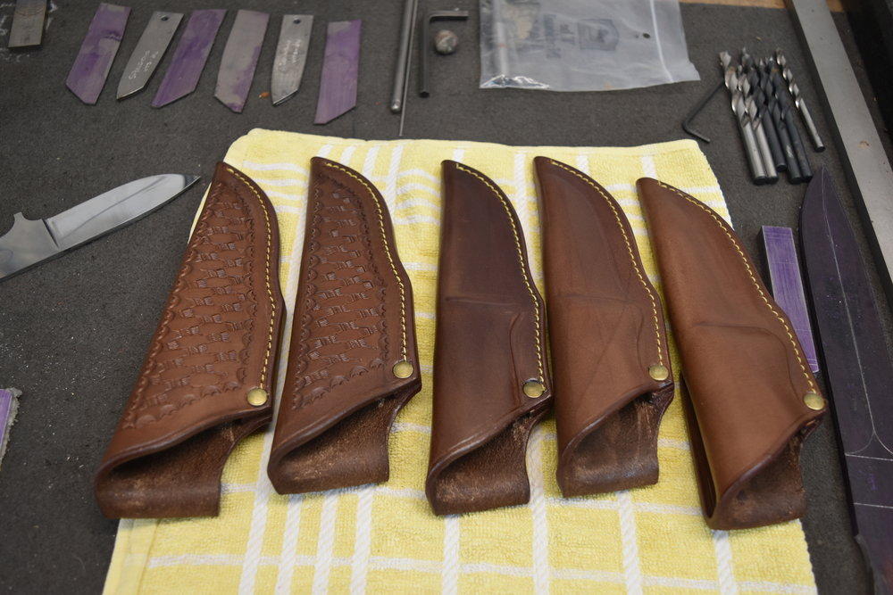 Some of the Auckland-made custom-designed sheaths Brent can provide with his knives