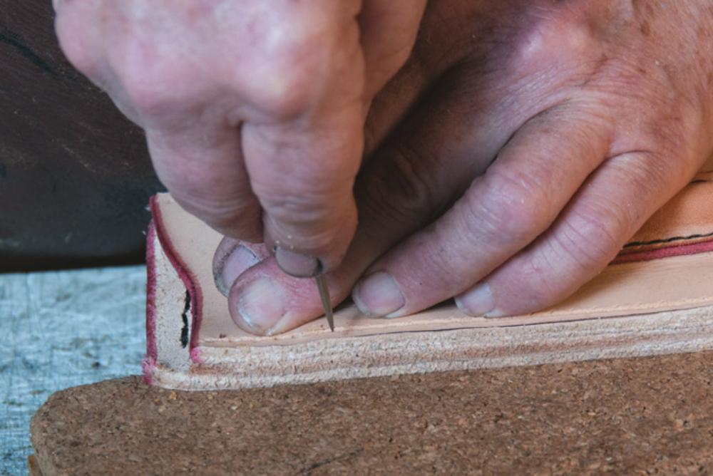 Stabbing stitch holes.